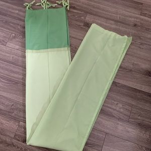 2 long green curtains. Price is for both